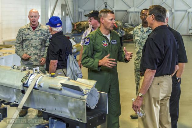 Lieutenant Colonel Scott Walker, Deputy Operations Group Commander, briefs Wild Weasel veterans on the GBU-39 Small Diameter Bomb (SDB). (Photo by Scott Wolff)