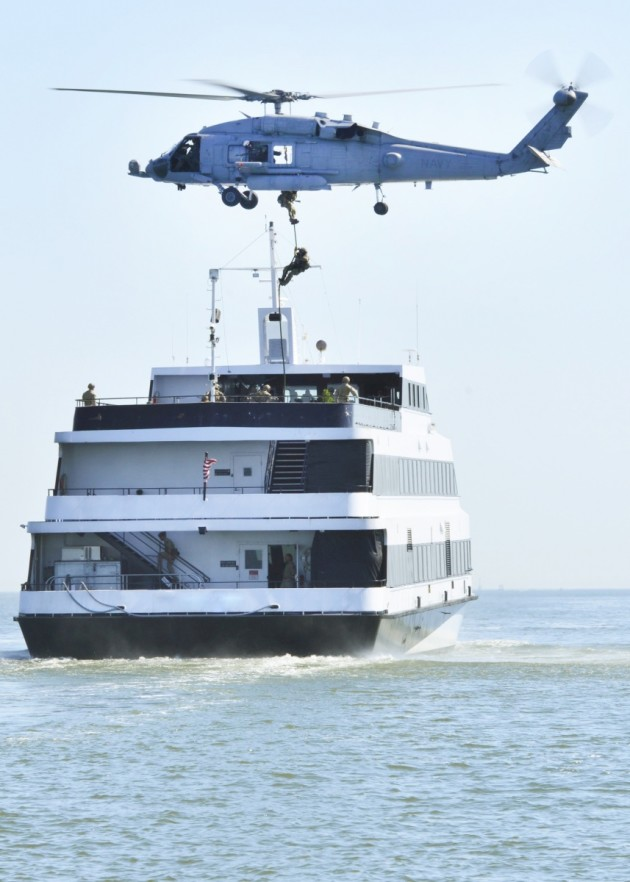 HSC-84 fastropes a CG MSST element to a vessel during a cross-training event.