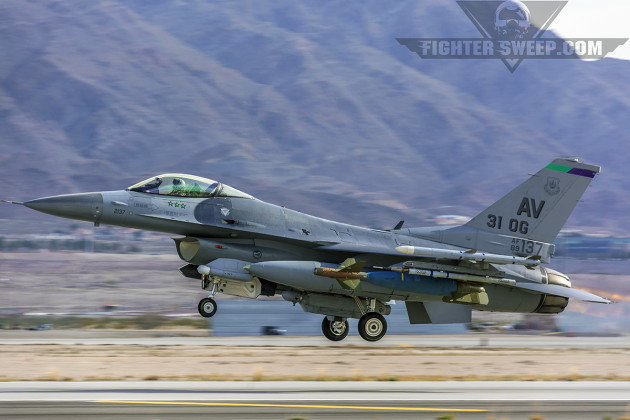 A Block 40 F-16CM, flagship of the 31st Operations Group and a triple MiG-killer, takes to the sky with an inert LGB during Red Flag 15-1 at Nellis Air Force Base, NV.