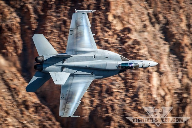 A Boeing F/A-18E Super Hornet turns the corner on a low level route
