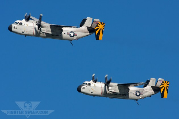"""A pair of C-2s from VRC-30 """"Providers"""" taking part in the Centennial of Naval Aviation flypast"""