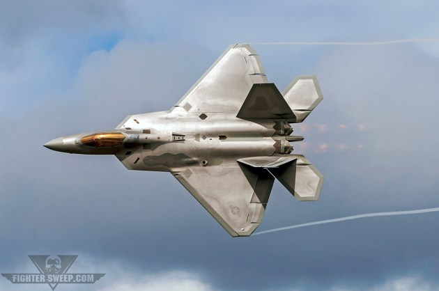 A Lockheed-Martin F-22 Raptor carves through the airspace during a tactical demonstration above Joint Base Elmendorf-Richardson in Alaska. (Photo by Scott Wolff)