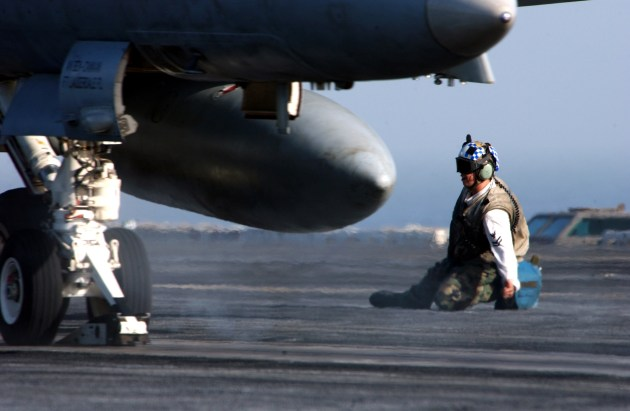 "A troubleshooter clears an F/A-18C Hornet assigned to the ""Blue Diamonds"" of Strike Fighter Squadron One Four Six (VFA-146) for launch from one of four steam-driven catapults on board the Nimitz-class aircraft carrier USS Carl Vinson (CVN 70). U.S. Navy photo by Photographer's Mate 2nd Class Inez Lawson (RELEASED)"