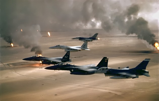 U.S. Air Force fighters fly over burning oil fields in Kuwait after Saddam Hussein ordered them to be set ablaze. (U.S. Air Force Photo)