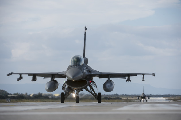 Hellenic air force F-16 Fighting Falcon fighter aircraft assigned to the 340th Fighter Squadron taxi on the flightline during a flying training deployment at Souda Bay, Greece, Jan. 27, 2016. The U.S. Air Force conducts military training with allies and partners to bolster operational readiness and capability. (U.S. Air Force photo by Staff Sgt. Christopher Ruano/Released)