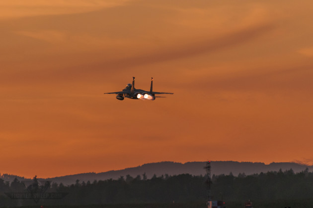 "Colonel Adam ""Kahn"" Sitler takes off into an Oregon sunset, en route to the coast for a night training mission. (Photo by Scott Wolff)"