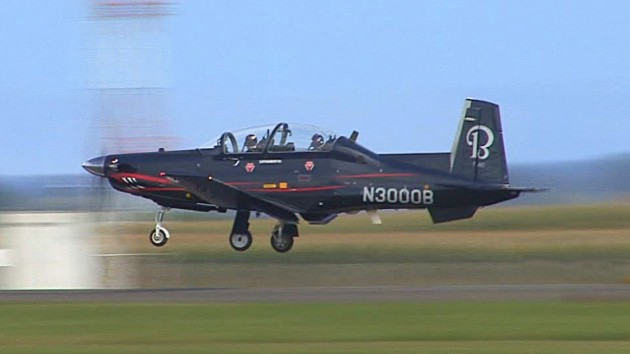 A Beechcraft (Textron Aviation Defense) T-6C Texan II demonstrator departs for a training flight. (Photo courtesy of YouTube)