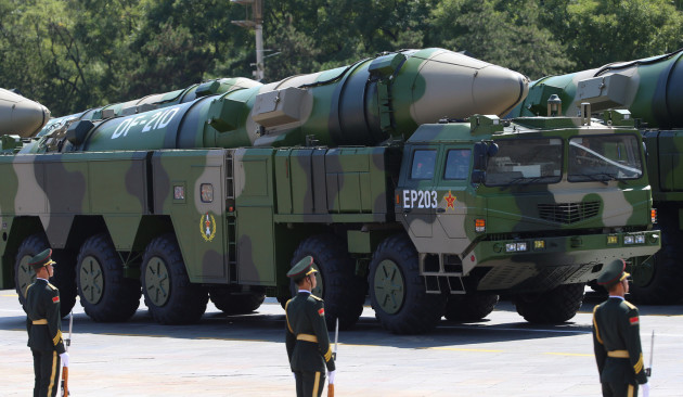 epa04910030 Dong Feng (East Wind) DF-21D anti-ship ballistic missile launchers move through Tiananmen Square during a military parade marking the 70th Anniversary of the Victory of Chinese People's Resistance against Japanese Aggression and World Anti-Fascist War at Tiananmen Square in Beijing, China, 03 September 2015. China holds a military parade as one of the events taking place around the World marking the 70th Anniversary of the WWII Victory over Japan Day which marks the day Japan officially accepted the terms of surrender imposed by the by Allied Forces in the Pacific conflict. EPA/WU HONG
