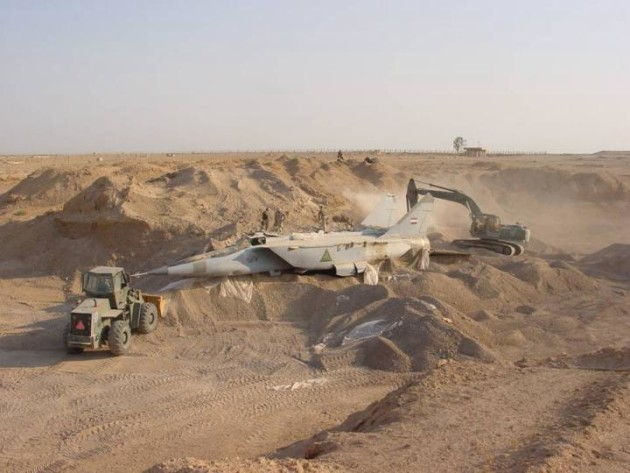An Iraqi MiG-25 FOXBAT is dug out after the initial Operation IRAQI FREEDOM offensive in 2003. (U.S. Air Force Photo)