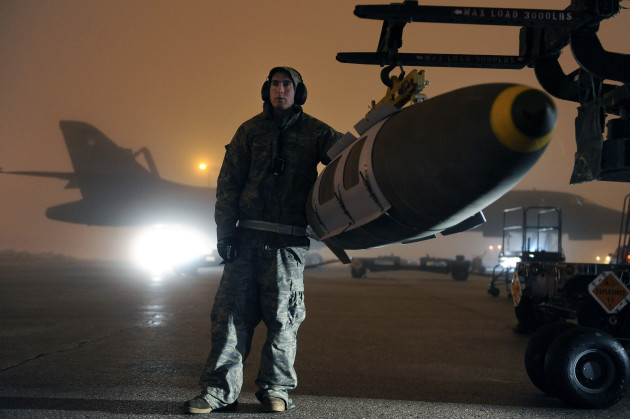 Airman Michael Doto, 28th Aircraft Maintenance Squadron weapon systems technician, steadies a GBU-31 joint direct attack munition while preparing to load it on a B-1B Lancer on Ellsworth Air Force Base, S.D., March 27, 2011. B-1B Lancers from the 28th Bomb Wing launched early Sunday, March 27 to strike targets in Libya from their home station of Ellsworth Air Force Base in support of Operation Odyssey Dawn. (U.S. Air Force photo/Staff Sgt. Marc I. Lane)