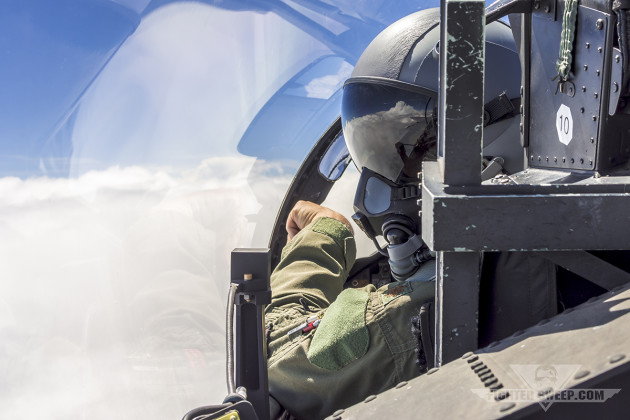 """""""Chew"""" looks outside the cockpit of his F-15 Eagle during a Large Force Employment exercise last summer. (Photo by Scott Wolff)"""
