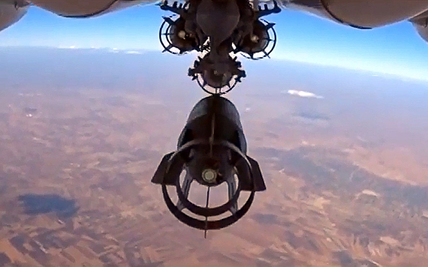 "TOPSHOTS A video grab made on October 6, 2015, shows an image taken from a footage made available on the Russian Defence Ministry's official website on October 5, purporting to show a Russia's Su-24M bomber dropping bombs during an airstrike in Syria. AFP PHOTO / RUSSIAN DEFENCE MINISTRY RESTRICTED TO EDITORIAL USE - MANDATORY CREDIT "" AFP PHOTO / RUSSIAN DEFENCE MINISTRY"" - NO MARKETING NO ADVERTISING CAMPAIGNS - DISTRIBUTED AS A SERVICE TO CLIENTS-/AFP/Getty Images"