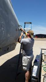Tim's son, Sgt Michael Baer (formerly 82md Airborne) helping sand down Fast Eagle 102.