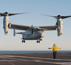 An MV-22 Osprey from Marine Medium Tiltrotor Squadron (VMM) 166 approaches for a touch-and-go landing on the flight deck of the aircraft carrier USS Carl Vinson (CVN 70). Carl Vinson is underway conducting Precision Approach Landing System (PALS) and flight deck certification. US Navy photo PO3 George Bell