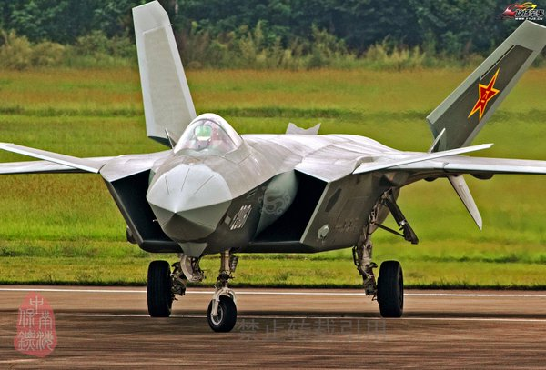 Chinese J-20. Note the Raptor like appearance and intake designs.