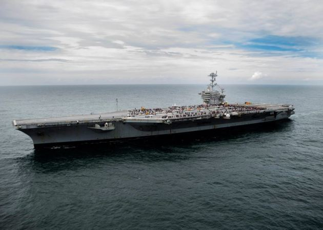 The aircraft carrier USS George Washington (CVN 73) transits the Atlantic Ocean during a Friends and Family day cruise. Washington is underway for a family and friends day cruise. George Washington is homeported in Norfolk after serving seven years in Yokosuka, Japan, as the U.S. Navy's only forward-deployed aircraft carrier. (U.S.Navy photo by Petty Officer 3rd Class Jessica Gomez)