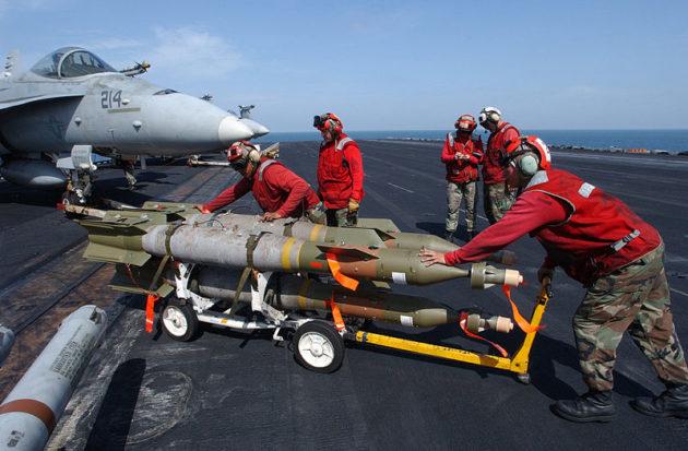 US_Navy_020303-N-4768W-026_Loading_bombs_on_aircraft_at_sea