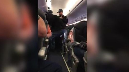 man-dragged-off-united-airlines-flight