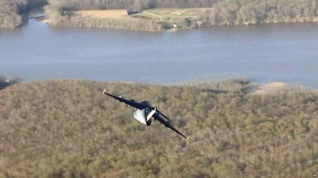 military-cargo-plane-flies-close-air-force-one