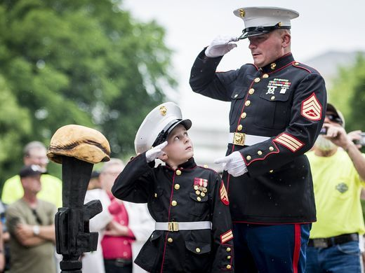 Former United States Marine Tim Chambers gives instructions to Christian Jacobs
