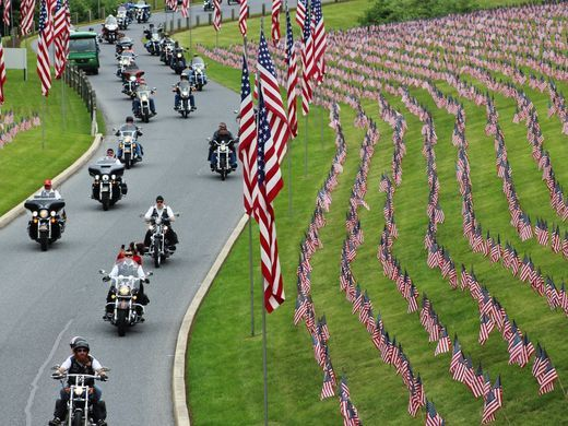 Motorcyclists ride into Indiantown Gap National Cemetery in Annville