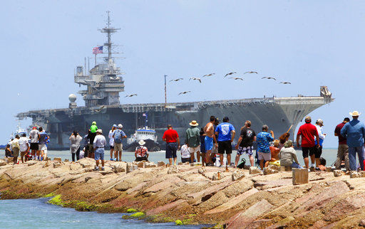 USS Independence towed into the Brownsville