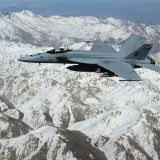 US_Navy_An_F-A-18E_Super_Hornet_assigned_to_the_Pukin_Dogs_of_Strike_Fighter_Squadron_VFA_143_flies_over_the_mountains_of_Afghanistan
