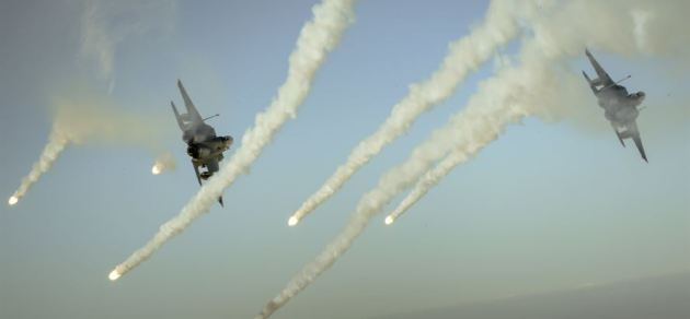 F-15E Strike Eagles fire flares over Iraq during a mission in support of Operation Inherent Resolve