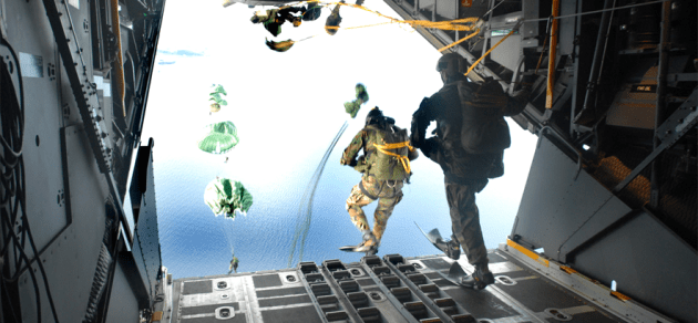 Pararescuemen from the 31st Rescue Squadron perform a static-line jump out of a C-130 Hercules