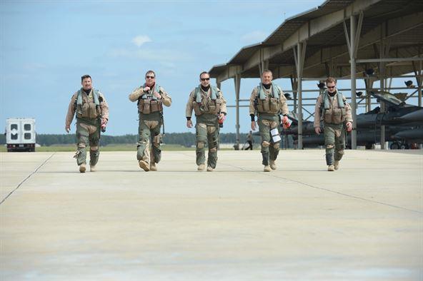 U.S. Air Force Capt. Hugh Walker, Maj. Brian Grossweiller, Capt. Jason Blodzinski, Capt. Joe Schenkel, and Capt. Patrick McAndrew, 77th Fighter Squadron pilots