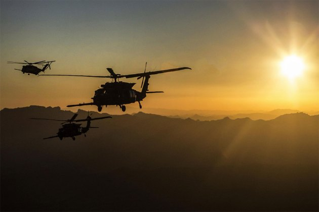 pair of U.S. Army MH-60M Blackhawks and a U.S. Marine Corps CH-53E Super Stallion