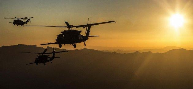 pair of U.S. Army MH-60M Blackhawks and a U.S. Marine Corps CH-53E Super Stallion