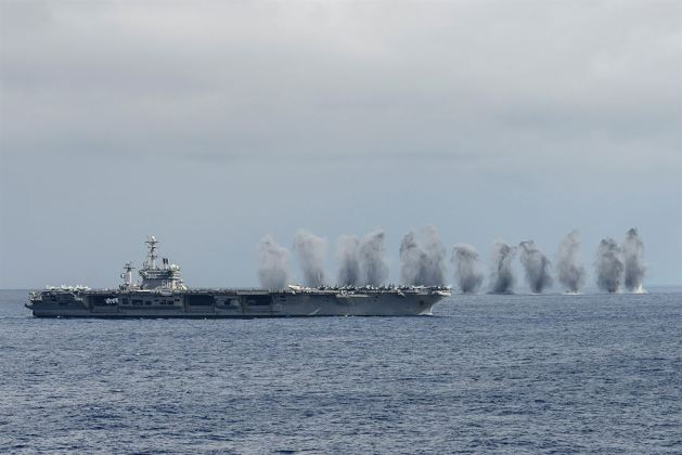Aircraft from Carrier Air Wing 11 drop live ordnance during a flight demonstration as part of Tiger Cruise