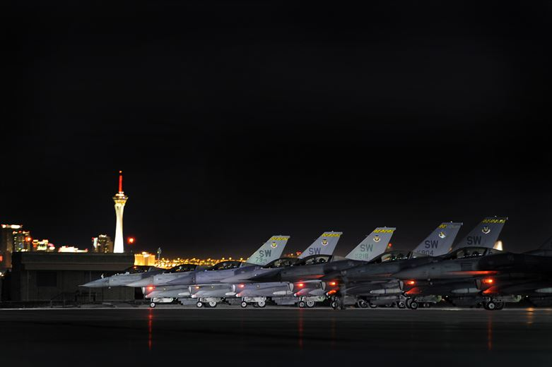 79th Fighter Squadron 'Tigers' pilots sit stacked on the Nellis AFB runway