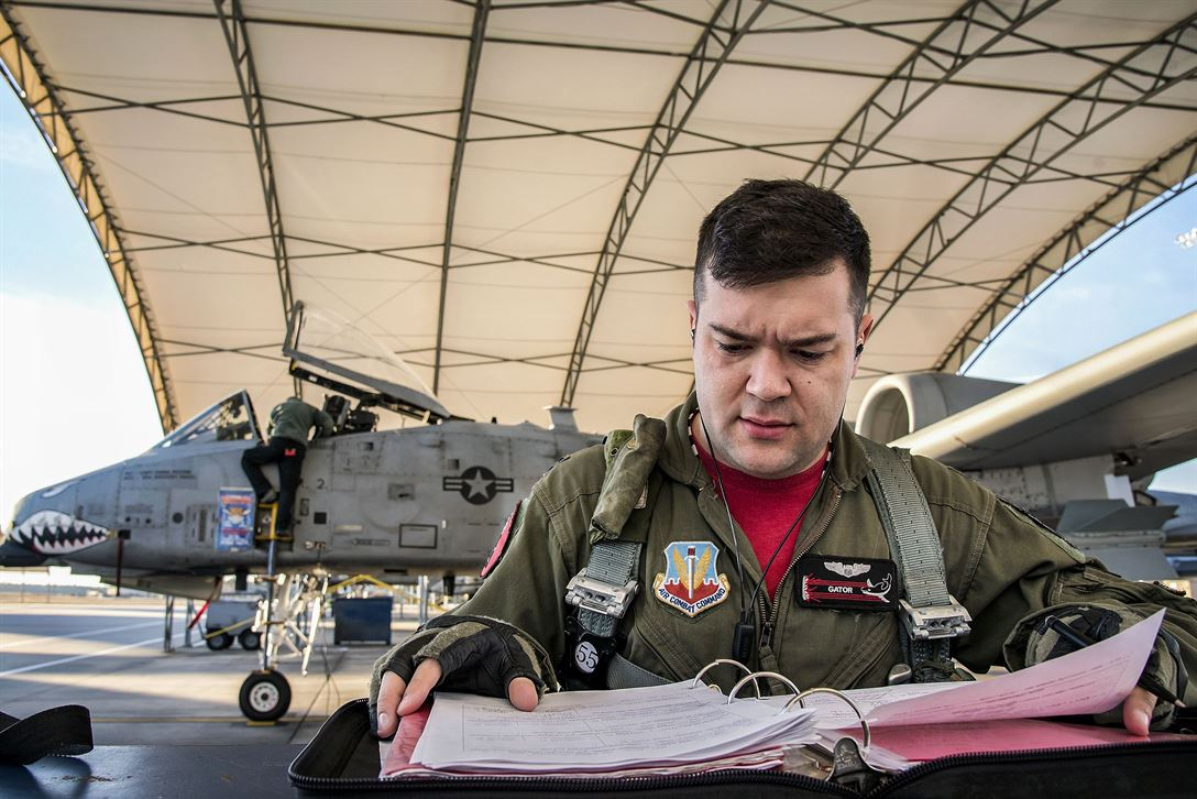 Air Force Capt. Haden Fullam, a 75th Fighter Squadron pilot, reads a flight plan at Moody Air Force Base