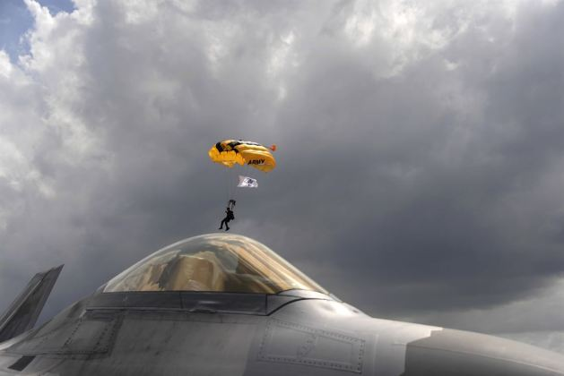 Army Golden Knights Drops in on an Air Force F-22 Raptor