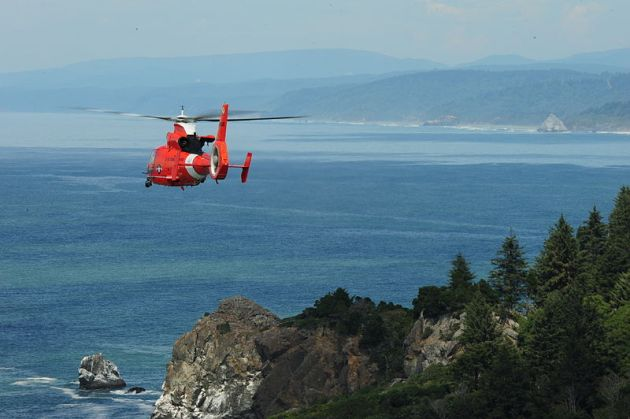 MH-65 Dolphin helicopter from Air Station Humboldt Bay transits over the Pacific Ocean