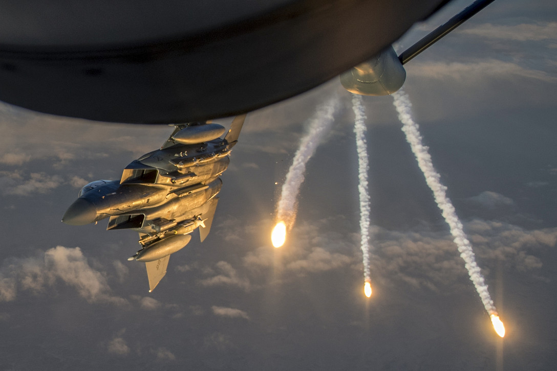 Air Force F-15 Eagle Deploys Flares Flying Away from KC-135 Stratotanker