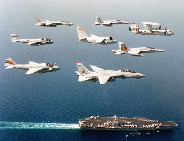 U.S. Navy aircraft assigned Carrier Air Wing 14 (CVW-14) fly over the aircraft carrier USS Carl Vinson (CVN-70)