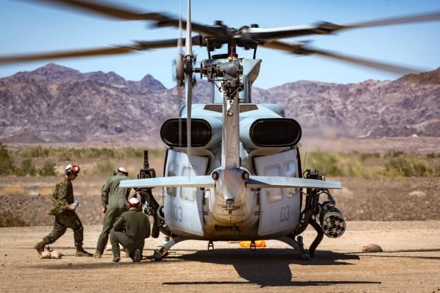 Marines arm a UH-1Y Venom helicopter