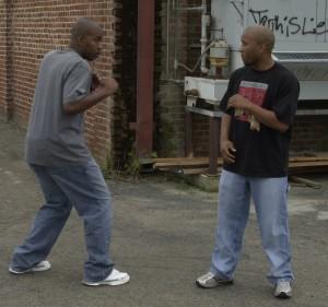 Two men fighting street fight