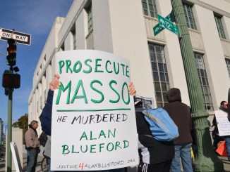 Oakland residents gather to protest the killing of Alan Blueford by an Oakland police officer.