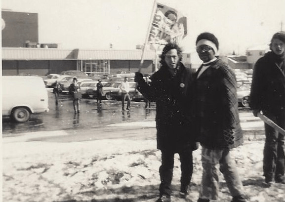 Two demonstrators stand against the National Action Group, a white supremacist group, at an event in February 1972.
