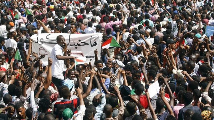 Sudanese residents gather to demonstrate against the Sudanese government.