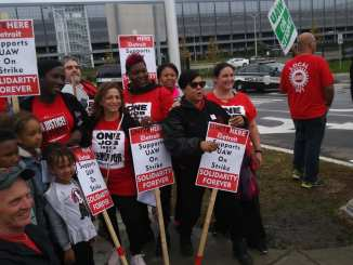 A contingent from UNITE HERE union joins the picket line outside the General Motors Tech Center in Warren