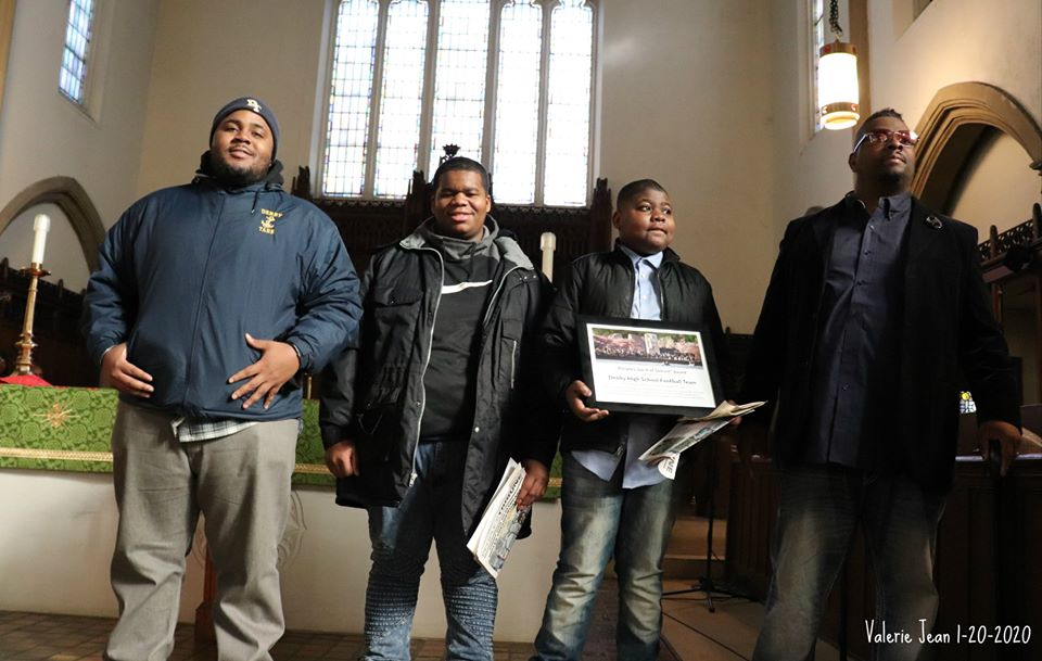 Denby High football players with Coach deon Godfrey at 2020 Detroit MLK Day Rally