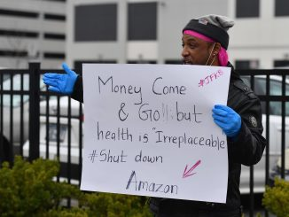 Amazon worker demonstrates against lack of safety and adequate pay
