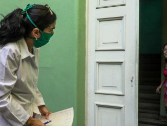Cuban doctor goes door-to-door in Havana on March 31 looking for possible cases of coronavirus