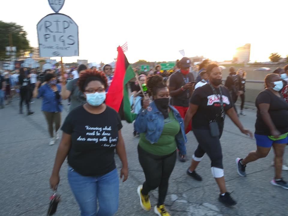 Detroit 100 Days Victory March moving through downtown chanting militant slogans in opposition to racism and capitalism