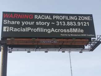 Racial Profiling billboard on 8 Mile Road